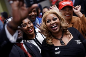 Attendees wearing pro-Trump clothing and accessories pose for a wefie at U.S President Donald Trump's Black Voices for Trump Coalition rollout event in Atlanta, Georgia, U.S. November 8, 2019. REUTERS/Elijah Nouvelage