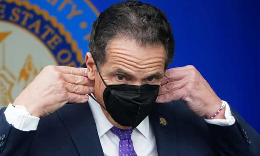 Andrew Cuomo adjusts his face mask during an event in New York City.