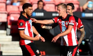 Che Adams of Southampton celebrates with teammates after scoring his team's first goal.