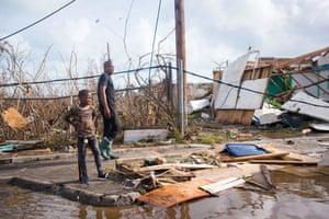 People look at damage in Marigot, on the island of Saint-Martin