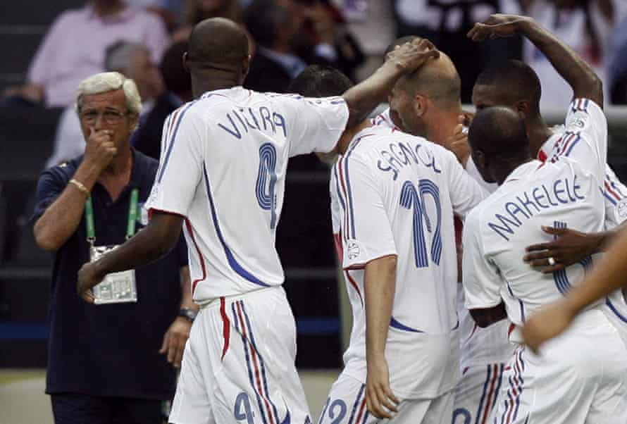 The Italy coach, Marcello Lippi, looks on as the French players celebrate Zidane's goal in the final.