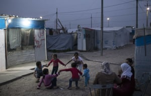 Syrian children play outside their tents in the Kawergosk refugee camp in northern Iraq.