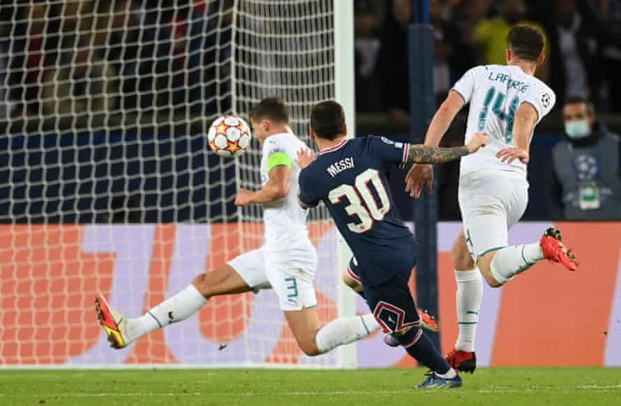 Lionel Messi guides his shot into the roof of the net.