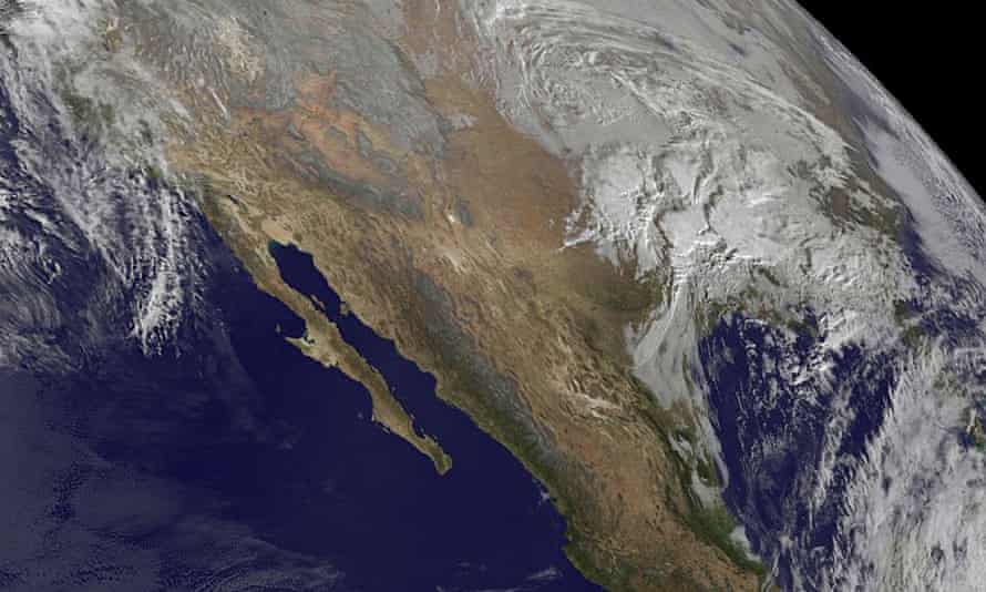 A Nasa satellite image showing the snow storm looming over the US east coast.