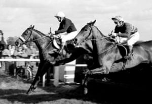 Red Rum and Brian Fletcher lead Fort Lodge and Graham Thorner over a fence at Kempton Park