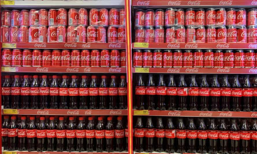 Coca-Cola bottles and cans on sale in Nigeria.