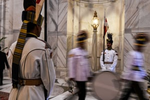 Soldiers stand guard before a swearing-in ceremony at Durbar Hall in the presidential palace.