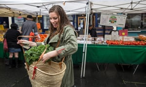 'The unofficial face of trendy environmentalism is a smiling white woman.' Here Kathryn Kellogg, a zero-waste practitioner, shops at a farmers' market.