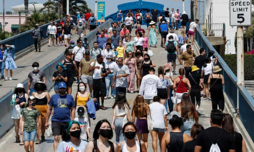 People walk in Santa Monica, California. The Census Bureau results showed that US metro areas accounted for almost all the country's population growth.