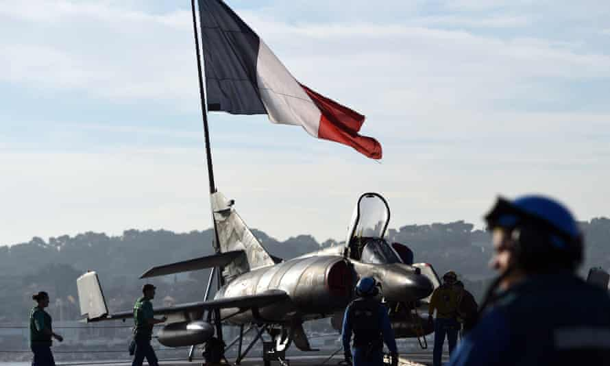 A French jet on the flight deck of the aircraft carrier Charles de Gaulle at the port of Toulon on Wednesday