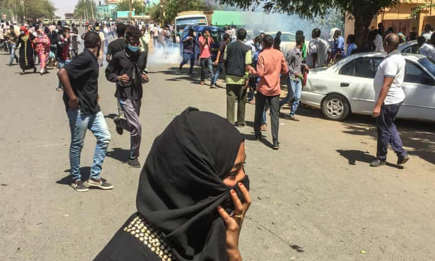 Sudanese protesters run for cover after police fired teargas canisters at a demonstration in Khartoum.