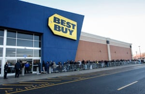 A Best Buy Employee opens the door to customers for Black Friday in Jersey City, New Jersey.