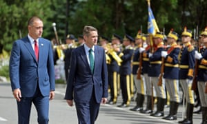 Gavin Williamson, the defence secretary (2nd from left) and the Romanian defence minister Mihai Fifor inspect a guard of honor upon Williamson's arrival at the Ministry of Defence, in Bucharest, Romania.