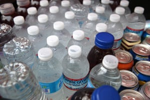 Bottles of water sit in a cooler at a hot dog stand in San Francisco, California