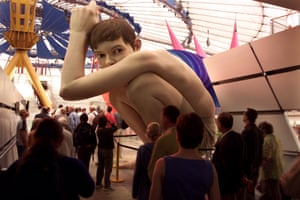Boy by Ron Mueck on display inside the dome.
