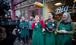 Nicola Sturgeon, with SNP candidate for Edinburgh South Catriona MacDonald (second from right), during a visit to Digin Community Greengrocer in Edinburgh.