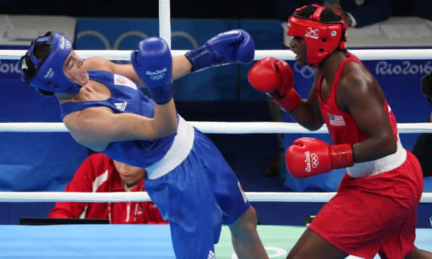 Claressa Shields (right) hurts her opponent Nouchka Fontijn during their contest on Sunday