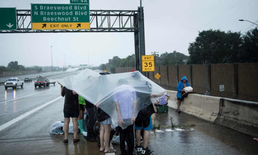 Evacuation residents from Meyerland wait on an I-610 overpass for further help during the aftermath of Hurricane Harvey.