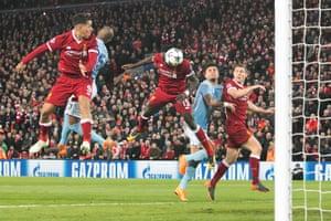 Sadio Mane heads in Liverpool's third.