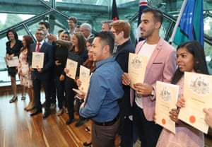Refugee footballer Hakeem Al-Araibi (second from right) receives his Australian citizenship during a ceremony at Federation Square in Melbourne.