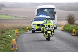 Diamond Princess evacuees depart from Boscombe Down airfield with a police escort