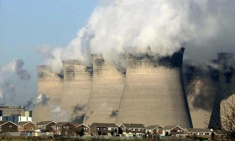 Steam rises from the cooling towers at a coal-fired power station.