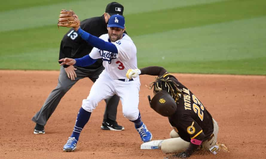San Diego Padres shortstop Fernando Tatis Jr (23) steals second base ahead of the tag by Los Angeles Dodgers second baseman Chris Taylor during a game last month