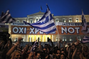 epa04824362 NO supporters demonstrate in central Syntagma Square, in front of the Greek parliament building, in Athens, Greece, 29 June 2015. Greek voters will decide in a referendum on next Sunday whether their government should accept an economic reform package put forth by Greece's creditor. Greece has imposed till the referendum capital controls and the banks will be closed till then. EPA/FOTIS PLEGAS G.