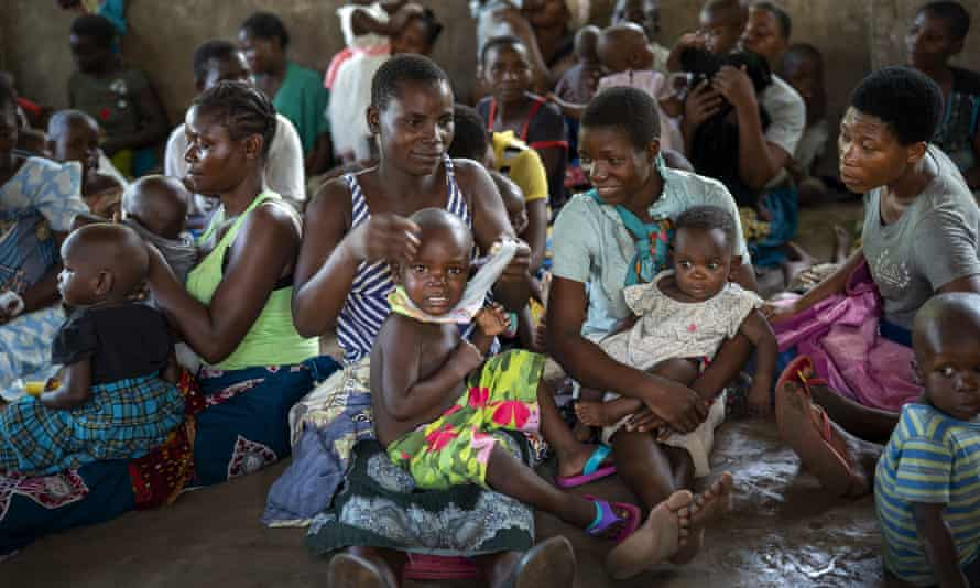 Children in Malawi wait to be injected with a vaccine against malaria in a WHO pilot project. It fears Covid may have set back its efforts by 20 years.
