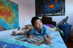 Nine-year-old James plays in his bedroom