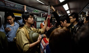 Victor Yu, a history student, rides the subway in Hong Kong on December 25, 2016 to an event marking 75 years since the British surrendered to the Japanese during World War II.
