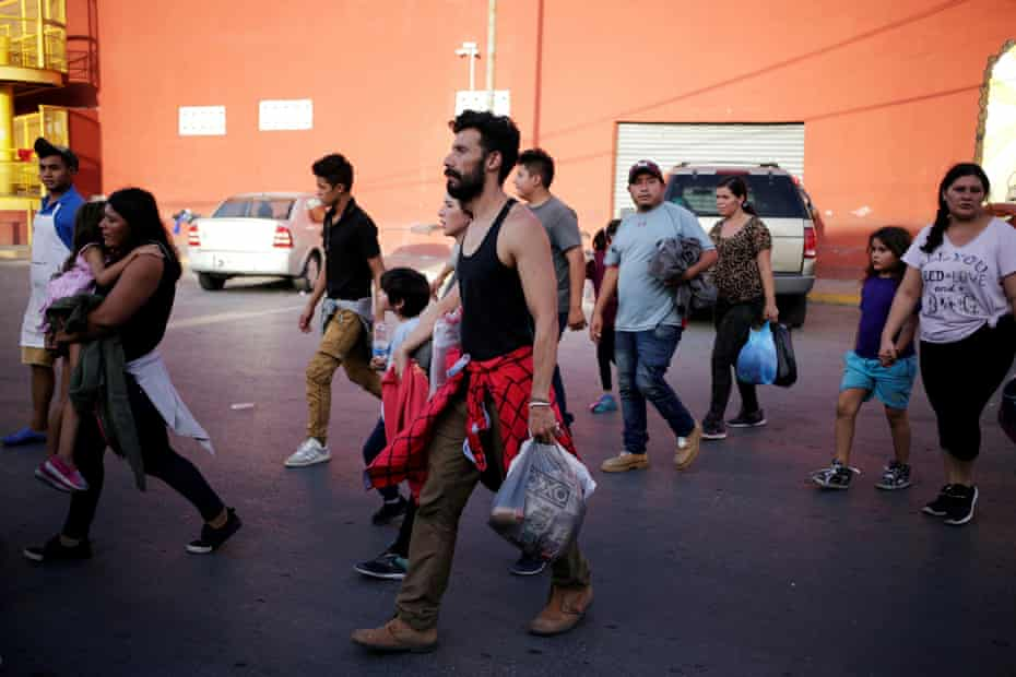 Central American migrants, returned from the US to Nuevo Laredo in Mexico under the Migrant Protection Protocol (MPP) to wait for their court hearing for asylum seekers, on 31 July 2019.