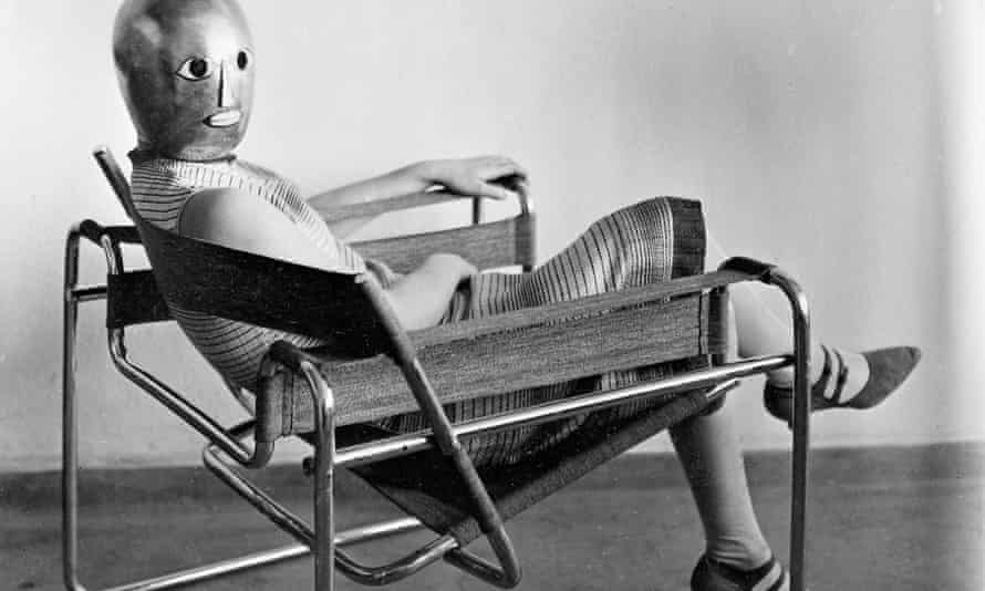 Bauhaus woman with mask sitting in chair