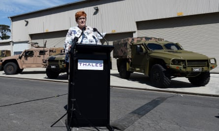Then-Defence Minister Marise Payne in front of Hawkei vehicles.