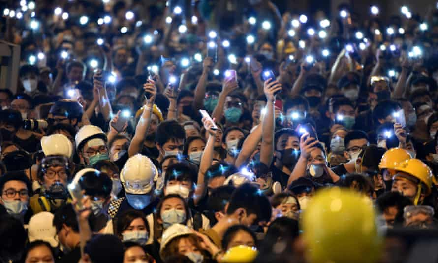Protesters converging on Hong Kong's police headquarters last week.