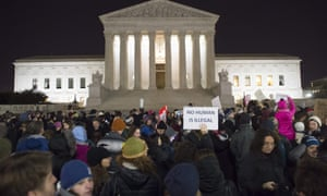 Demonstrators protest against Donald Trump and his administration's ban of travelers from seven countries by executive order, during a rally outside the US supreme court on 30 January 2017.
