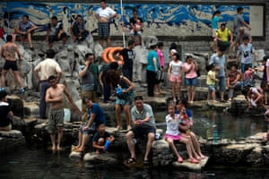 Residents cool off at a pool in Jinan in eastern China's Shandong province.