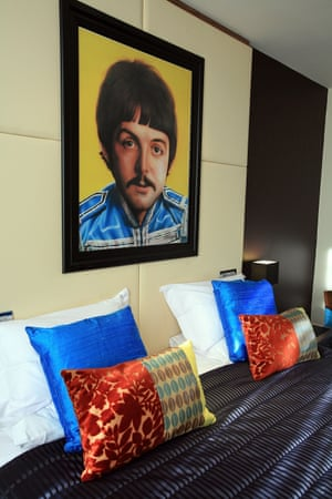 A portrait of Paul McCartney by acclaimed Beatles artist Shannon hangs on the wall of a suite at the newly-opened Hard Days Night Hotel
