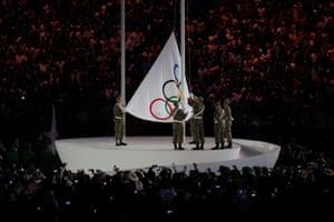The Olympic flag is raised in the Maracanã.