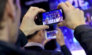 Visitors use their mobile phones' cameras during the 2015 Mobile World Congress (MWC) in Barcelona.
