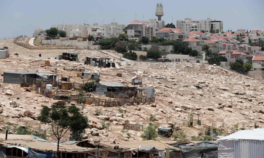 Bedouin tents and structures in front of the Israeli settlement of Maale Adumim in the occupied West Bank