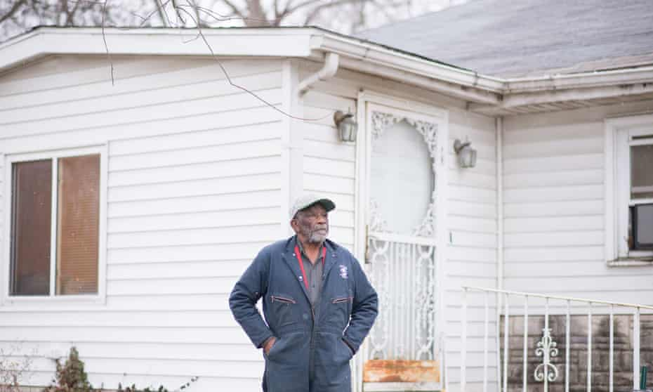 Earlie Fuse stands outside his home in the Piat Place neighborhood in Centreville. Over a month ago a rain event flooded the neighborhood, collapsing a basement wall he repaired in October.
