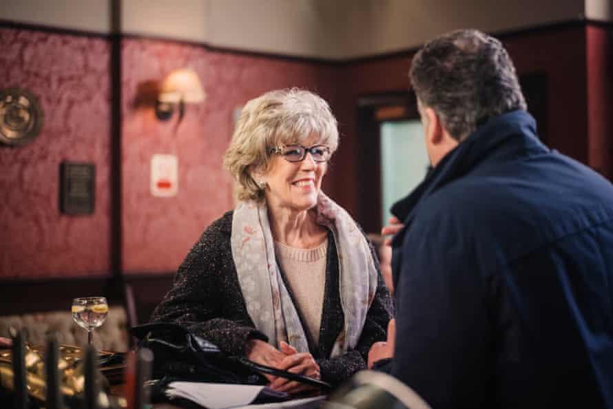 Sue Nicholls plays Audrey Roberts at the bar.
