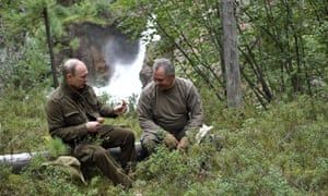 Putin and Russia's defence minister, Sergei Shoigu, pick mushrooms