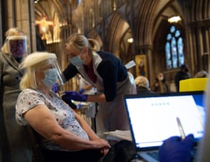 Audrey Elson, 84, receives an injection of the Oxford/AstraZeneca coronavirus vaccine at Lichfield Cathedral.