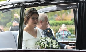 Princess Eugenie rides in a car with her father, the Duke of York, on her way to St George's Chapel