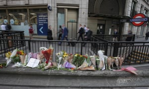 Flowers are left at Monument station near London Bridge in London on June 5, 2017 following the June 3 terror attack