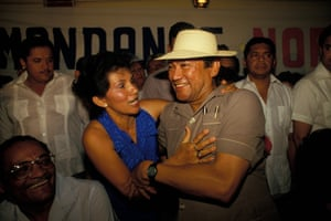Noriega enjoys the company of supporters at a social gathering in 1988