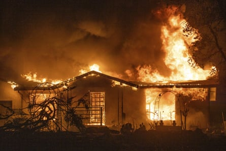 A house burns on Platina Road at the Zogg fire in Shasta county on Sunday.