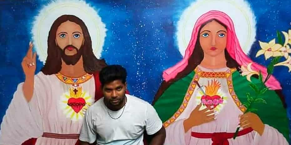 Thanush Selvarasa with the mural he painted for a small Catholic church in Papitalai parish on Manus Island.